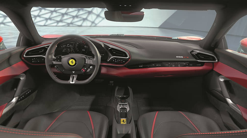 Справа тоже есть дисплей, чтобы пассажир не чувствовал себя выключенным из увлекательного процесса управления Ferrari, а представлял, что, например, он – штурман. На центральном тоннеле – рычаг переключения передач в стиле SF90 Stradale и ниша для хранения ключа зажигания с характерным значком гарцующей лошади.