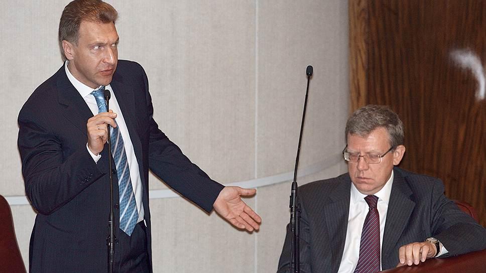 Министр финансов России Алексей Кудрин (справа) на заседании Государственной думы, 2009 год
