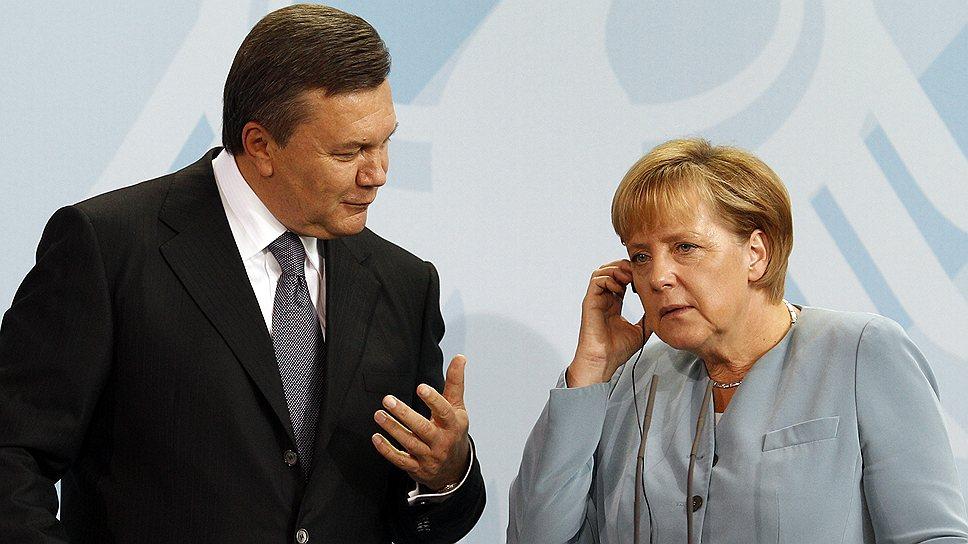 Президент Украины Виктор Янукович и канцлер Германии Ангела Меркель