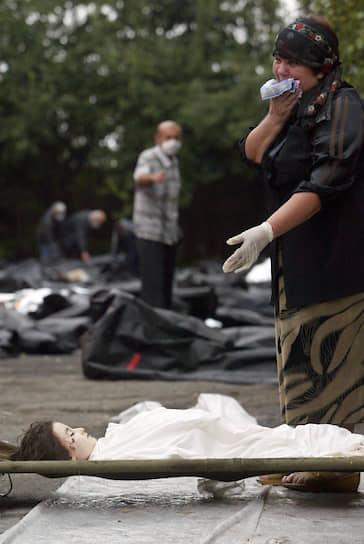 По завершении операции по освобождению заложников из-под завалов школы были извлечены тела 210 погибших