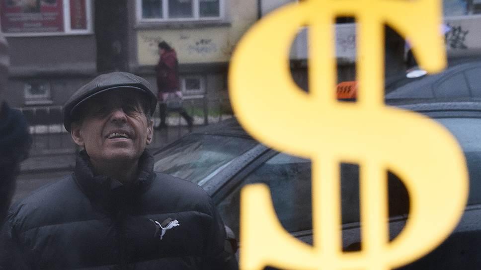 Курс доллара не удержался ниже 70 руб./$