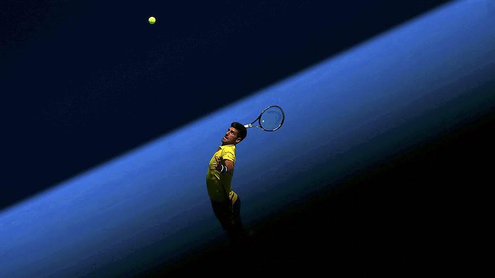 Мельбурн, Австралия. Сербский теннисист Новак Джокович играет матч против южнокорейского соперника Хейона Чанга