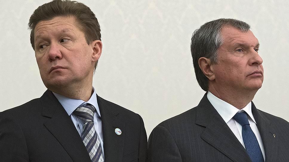 """Председатель правления компании """"Газпром"""" Алексей Миллер (слева) и  президент, председатель правления ОАО """"НК """"Роснефть"""" Игорь Сечин (справа)"""