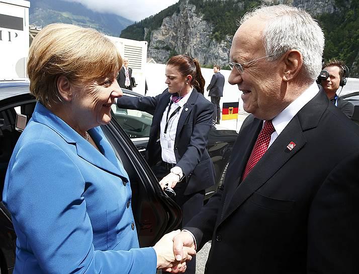 Канцлер ФРГ Ангела Меркель и президент Швейцарии Йоханн Шнайдер-Амманн