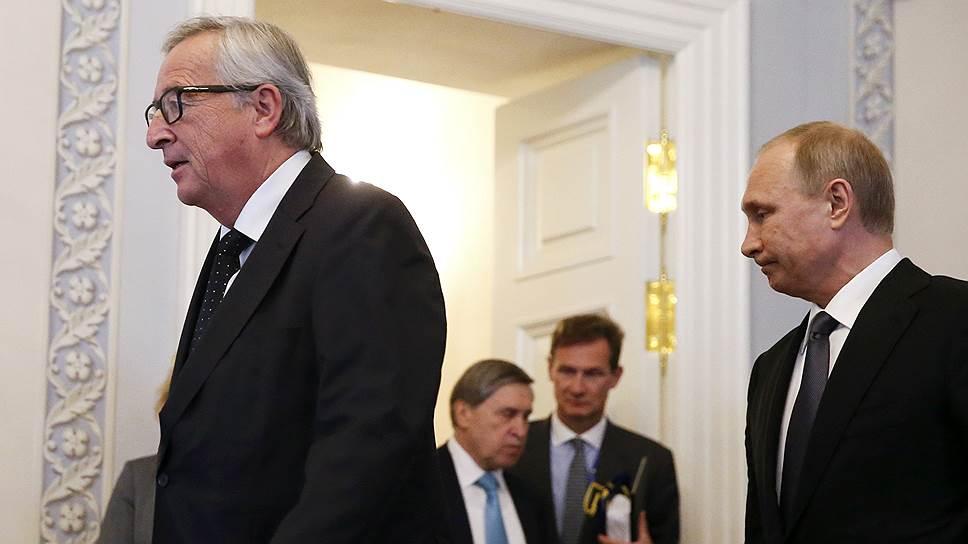 Председатель Еврокомиссии Жан-Клод Юнкер (слева) и президент России Владимир Путин