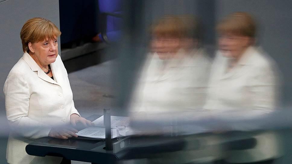 Какой жест перед началом саммита сделала Ангела Меркель