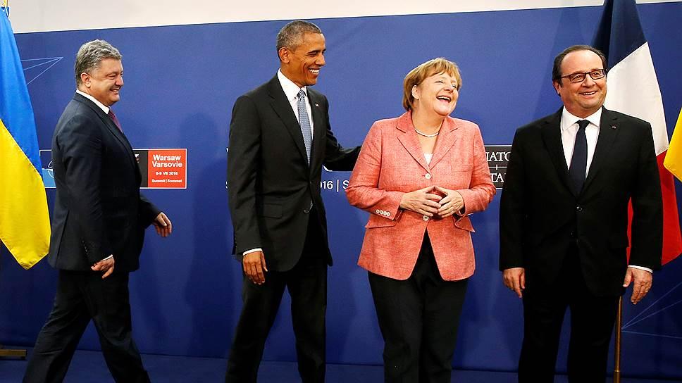 Слева направо: президент Украины Петр Порошенко, президент США Барак Обама, канцлер Германии Ангела Меркель и президент Франции Франсуа Олланд