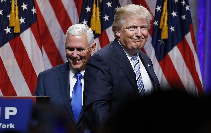Губернатор штата Индиана Майкл Пенс (слева) и кандидат в президенты США от Республиканской партии Дональд Трамп