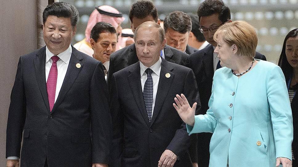 Слева направо: председатель КНР Си Цзиньпин, президент России Владимир Путин, федеральный канцлер ФРГ Ангела Меркель