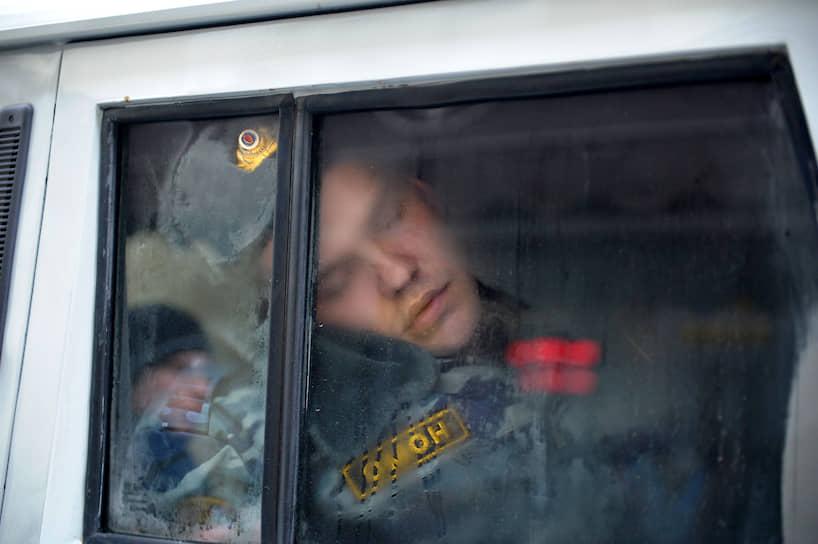 Сотрудник ОМОНа в служебной машине, 2012 год