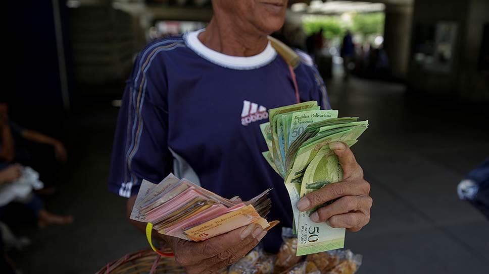 Как Венесуэла вступила на тропу дефолта
