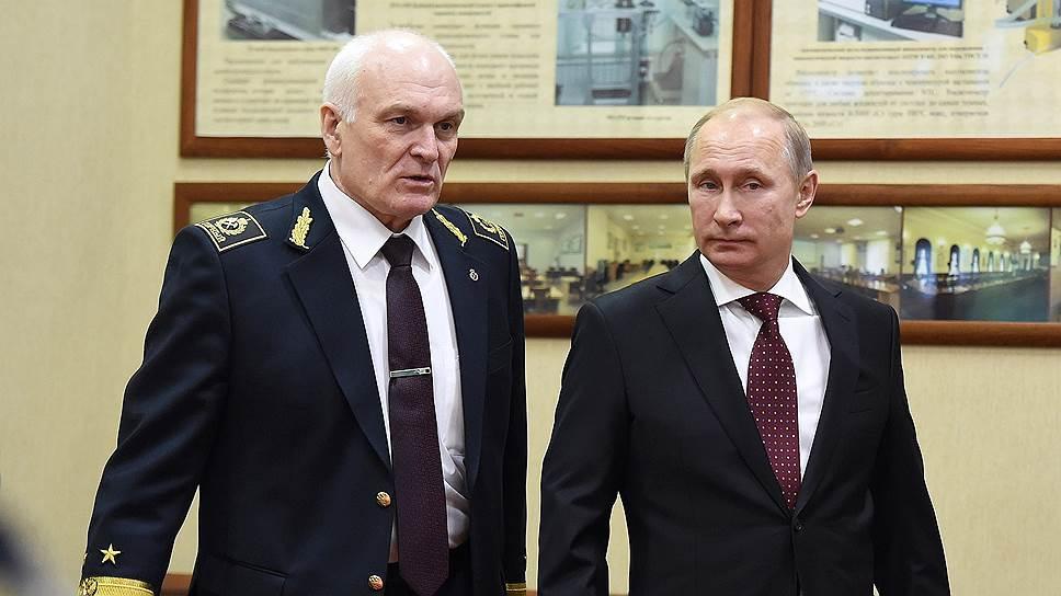 Ректор Санкт-Петербургского горного университета Владимир Литвиненко и президент России Владимир Путин