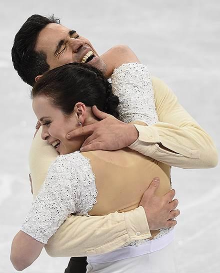Анна Каппеллини и Лука Ланотте (Италия) во время выступления в произвольной программе танцевальных пар в командных соревнованиях по фигурному катанию