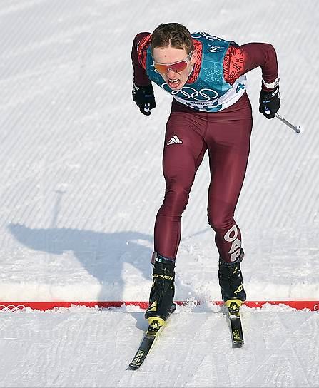 Российский лыжник Денис Спицов во время гонки на 15 км свободным стилем