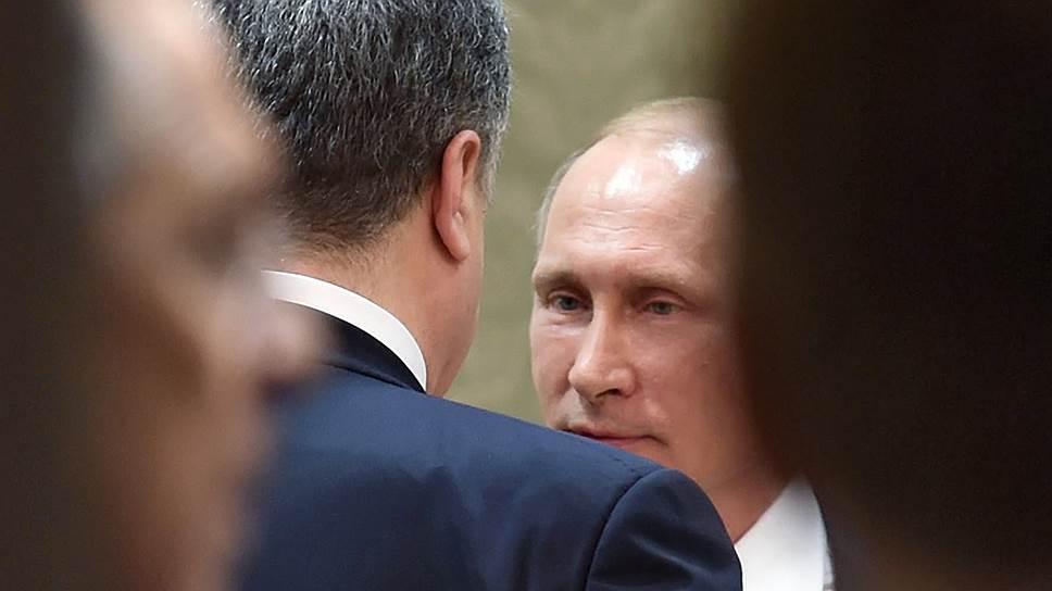 Как Владимир Путин и Петр Порошенко договорились о посещении заключенных омбудсменами