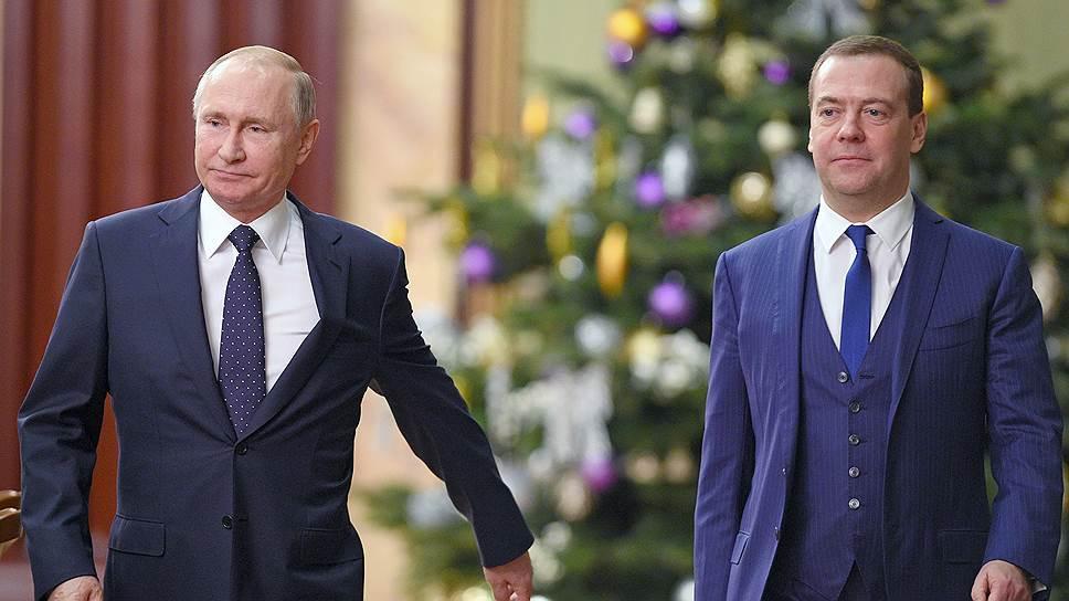 Президент России Владимир Путин (слева) и премьер-министр России Дмитрий Медведев