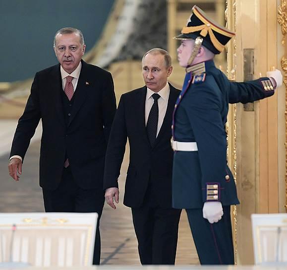 8 апреля, Москва. Лидеры России и Турции Владимир Путин и Реджеп Тайип Эрдоган (слева) на встрече с представителями российских и турецких деловых кругов