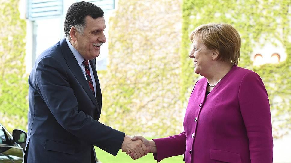Канцлер Германии Ангела Меркель и премьер-министр правительства национального согласия Ливии Файез Саррадж
