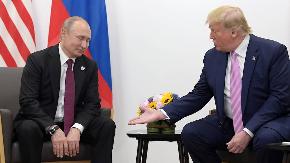Президент России Владимир Путин и президент США Дональд Трамп во время встречи в Японии в июне 2019 года