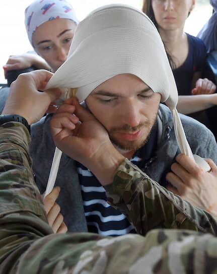 Учебные занятия по наложению повязки при травме головы