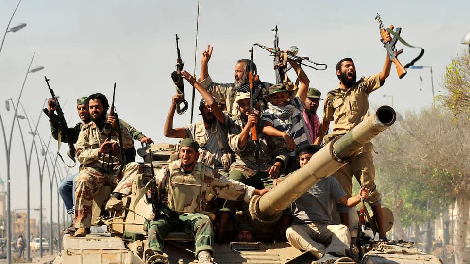 «Арабская весна», прежде всего падение режима Каддафи в Ливии, кардинально изменила политику России на Ближнем Востоке (Сирт, октябрь 2011 года)