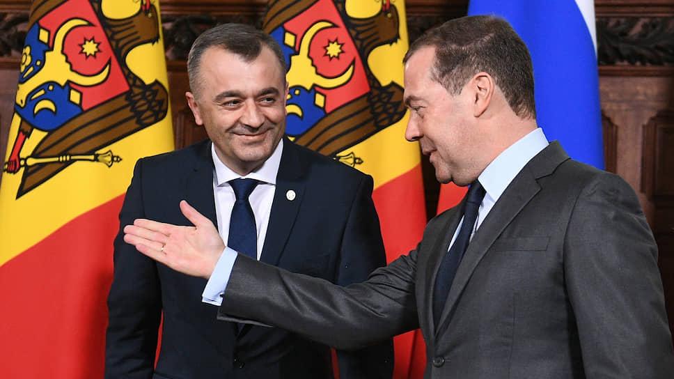 Премьер-министр Молдавии Ион Кику (слева) и премьер-министр России Дмитрий Медведев