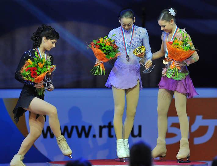 В сезоне 2011/12 фигуристка участвовала в двух турнирах Гран-при, завоевав две бронзовые медали. В финал серии не прошла, оставшись первой запасной <br> На фото слева направо: российская фигуристка Алена Леонова (серебро), японка Мао Асада (Золото) и Аделина Сотникова (бронза)