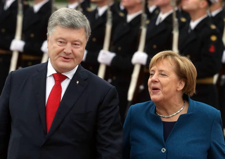 Во время визита в Киев с президентом Украины Петром Порошенко, 2018 год