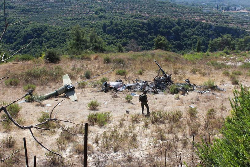 Во время спасательной операции один из вертолетов Ми-8 попал под обстрел и разбился на нейтральной территории <br> На фото: обломки на месте крушения Су-24 и вертолета Ми-8 спасательной группы