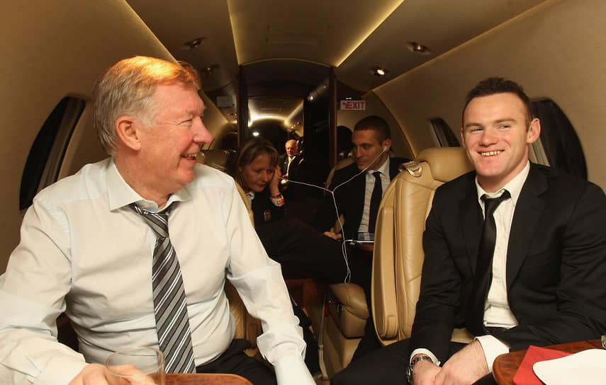 Играя за «Манчестер», Уэйн Руни 11 лет подряд входил в десятку самых высокооплачиваемых футболистов в мире по версии Forbes. Его состояние оценивается более чем в $160 млн<br> На фото: c главным тренером «Манчестер Юнайтед» Алексом Фергюсоном