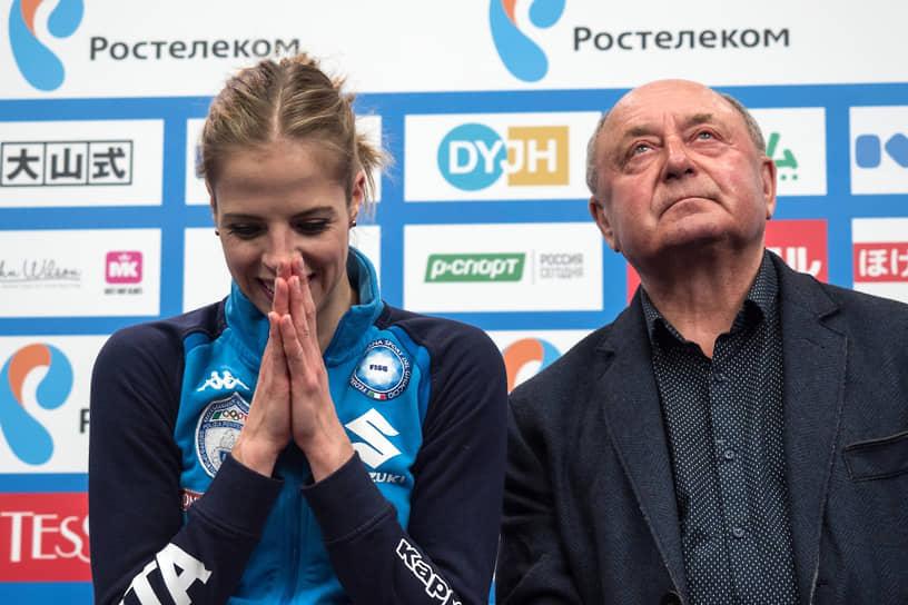 Итальянская фигуристка Каролина Костнер работает с тренером Алексеем Мишиным с 2016 года. Костнер — бронзовый призер Олимпийских Игр 2014, чемпионка мира, пятикратная чемпионка Европы, девятикратная чемпионка Италии