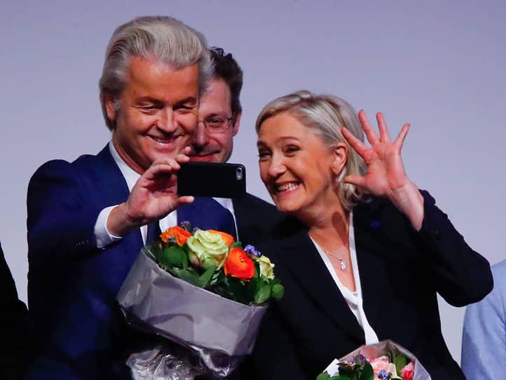 Лидер нидерландской Партии свободы Герт Вилдерс и глава французской партии «Национальный фронт» Марин Ле Пен на встрече европейских ультраправых лидеров, 2017 год
