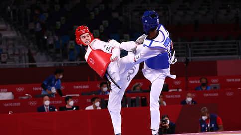 Михаил Артамонов утешился на бронзу  / Вторую медаль Олимпиады сборной России принесло тхэквондо