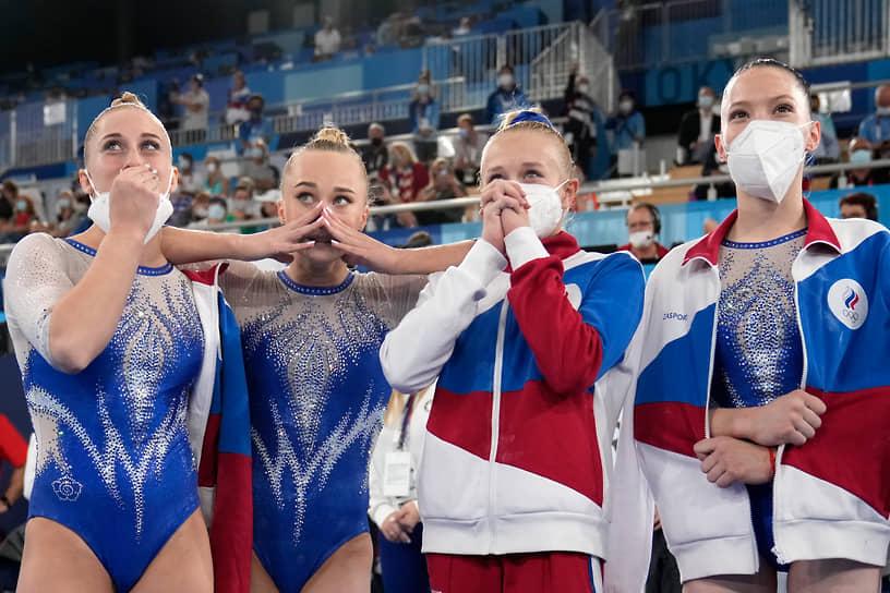 Золото. Слева направо: Лилия Ахаимова, Ангелина Мельникова, Виктория Листунова, Владислава Уразова. Спортивная гимнастика