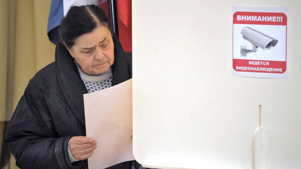 Голосование на одном из избирательных участков на президентских выборах в 2012 году