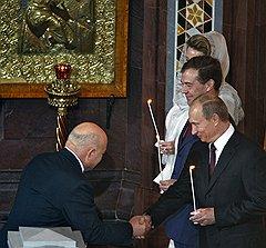 Бывший мэр Москвы Юрий Лужков, президент Дмитрий Медведев и председатель правительства России Владимир Путин