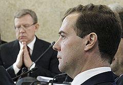 Бывший министр финансов России Алексей Кудрин и президент России Дмитрий Медведев