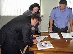 Бывший капитан милиции Максим Каганский (слева), фигурант дела о получении взятки на сумму 3 млн долларов следователем Нелли Дмитриевой