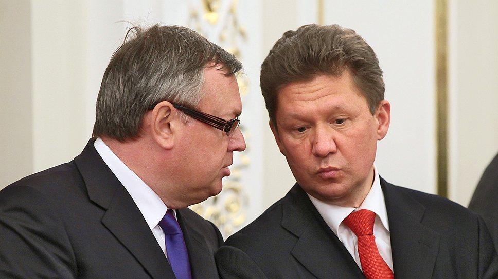 """Минюст предлагает считать президента банка ВТБ Андрея Костина (слева) и главу РАО """"Газпром"""" Алексея Миллера (справа) должностными лицами"""