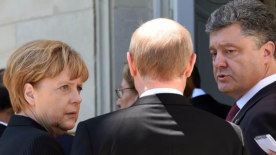 Канцлер Германии Ангела Меркель, президент России Владимир Путин и президент Украины Петр Порошенко