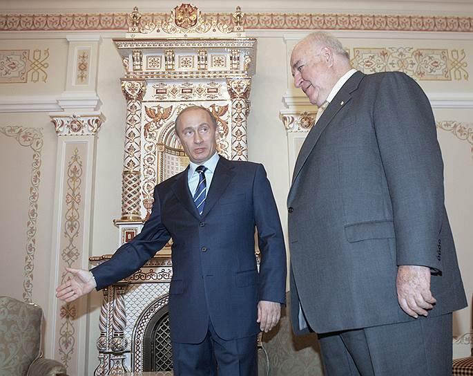 2005 год. Президент России Владимир Путин и бывший канцлер Германии Гельмут Коль