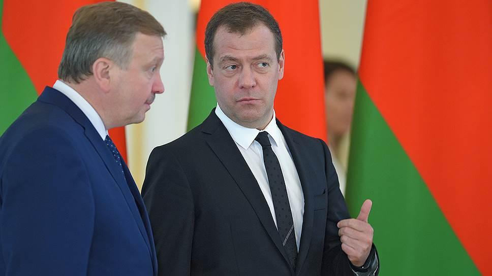 Окончание газового спора помогло главе правительства России Дмитрию Медведеву (справа) и премьер-министру Белоруссии Андрею Кобякову договориться и по вопросу белорусских долгов перед РФ