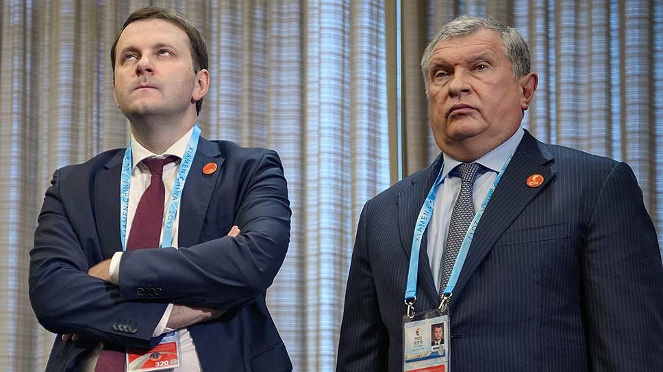 Минэкономики и госкомпании (слева — глава ведомства Максим Орешкин, справа — глава «Роснефти» Игорь Сечин) вряд ли сойдутся во взглядах на продажи непрофильных активов