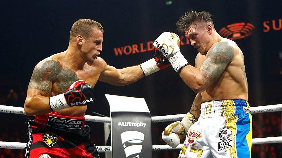 В финал одного из самых крупных проектов в истории бокса Александра Усика (справа) вывела очень тяжелая победа над Майрисом Бриедисом
