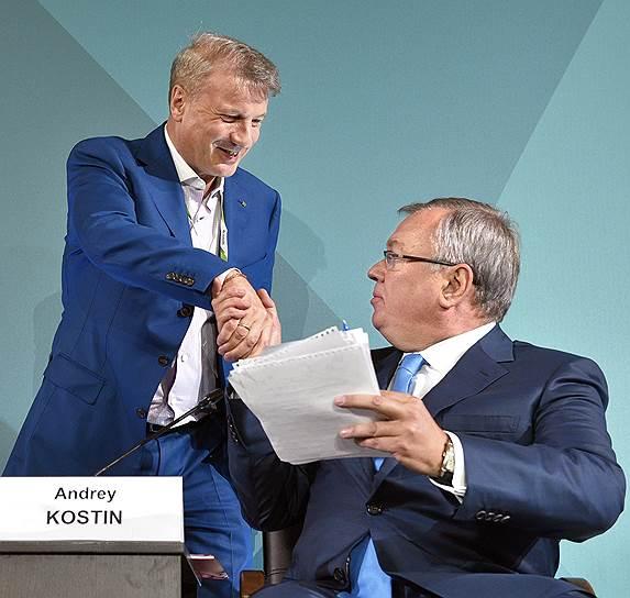 Главы Сбербанка Герман Греф (слева) и ВТБ Андрей Костин