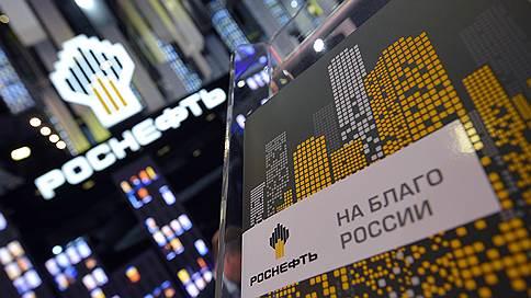 Роснефть решила тратить поменьше // Компания готова отложить проекты из-за неопределенности по налогам