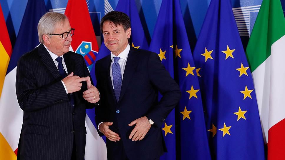 Премьер-министр Италии Джузеппе Конте (справа) и председатель Еврокомиссии Жан-Клод Юнкер