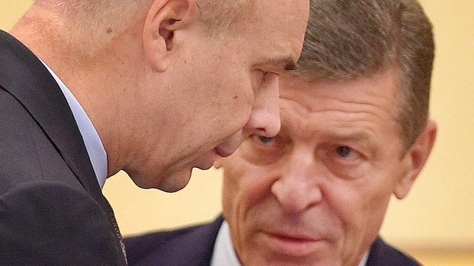 Первый вице-премьер Антон Силуанов (слева) и вице-премьер Дмитрий Козак (справа) пока не могут найти устраивающий всех новый формат инвестрежимов