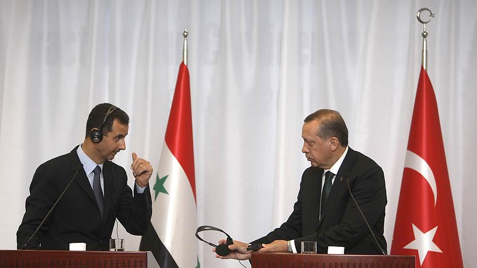 Президент Сирии Башар Асад (слева) и премьер-министр Турции Реджеп Тайип Эрдоган