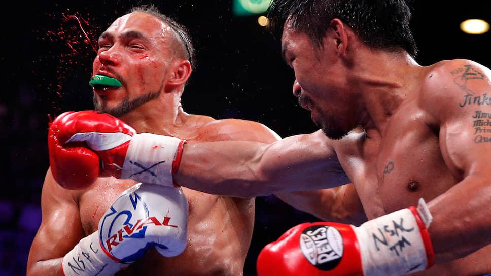 Победив Кита Турмана, Мэнни Пакьяо (справа) показал, что и в 40 лет остается выдающимся боксером